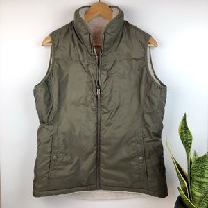 The North Face Reversible Faux Fur Vest in Olive